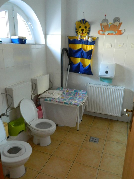 Nursery toilet and diaper changing table